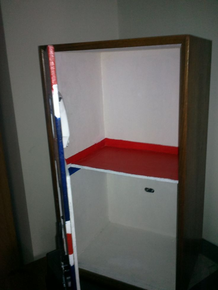 Shelf made with cardboard, painted with pva glue, set in place with filler