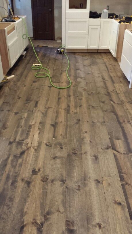 This is rustic 1x8 pine flooring stained with minwax for Color of hardwood floors