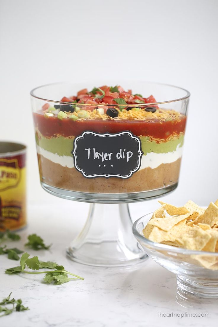 The BEST 7 layer dip recipe -layers of salsa, guacamole, sour cream, beans, cheese, pico de gallo and olives.