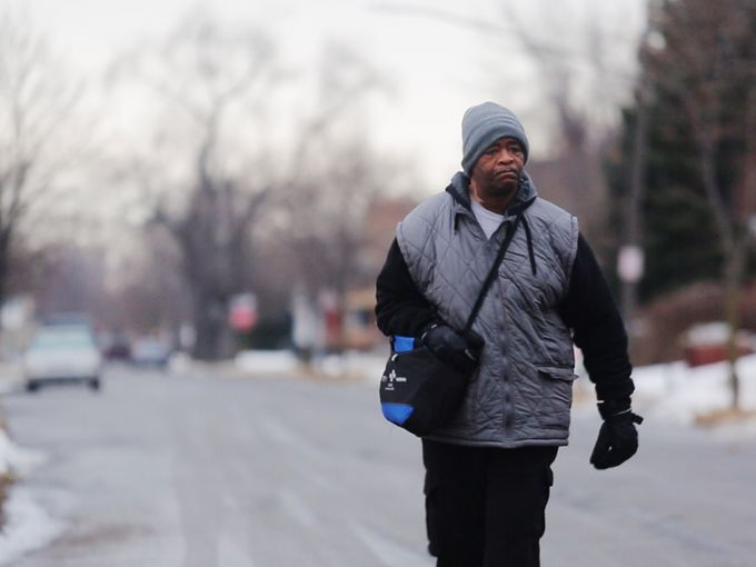 After the Free Press told of Detroiter James Robertson's arduous 21 miles of walking to and from his factory job, readers donated $200,000+ and Robertson hugged the WSU junior behind the fund-raiser.