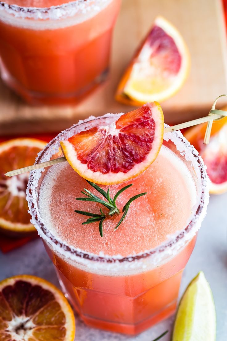 Rock your summer yard parties with this tasty blended Blood Orange Margarita and Rosemary! So easy to make and even easier to drink.: