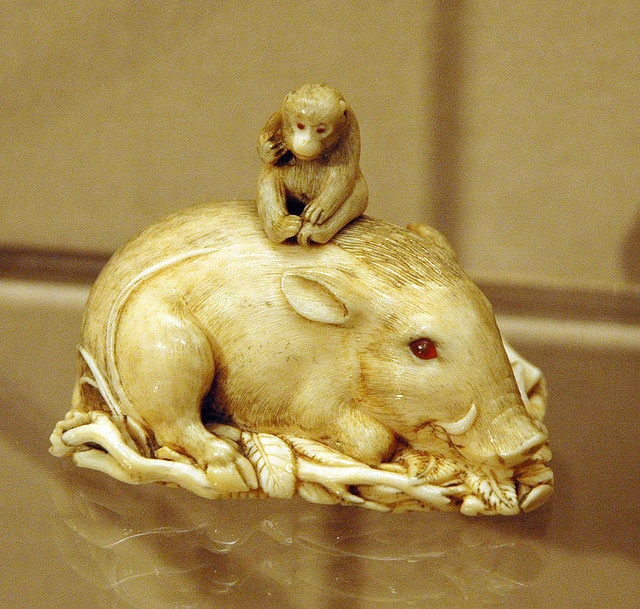 netsuke-monkey & boar  From the collection of the Asian Art Museum of San Francisco.