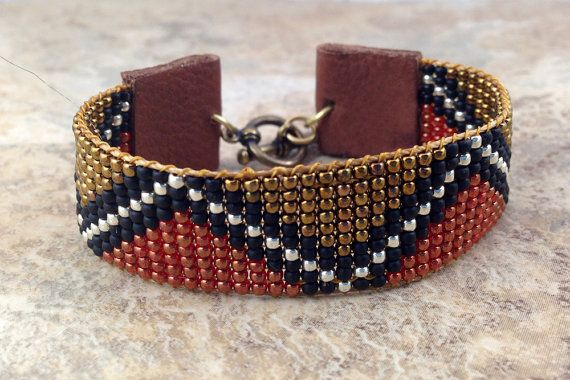 African textile inspired, Ethnic, Tribal loom woven beaded bracelet, 11/0 glass seed beads, leather tabs, brass toggle clasp