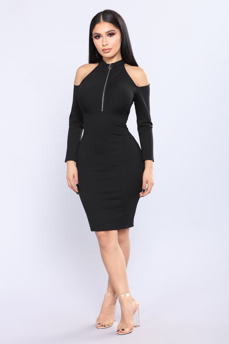 Available In Black Cold Shoulder Dress Mock Neckline  Quarter Zipper Detail  Long Sleeved  Ribbed Fabrication  65% Rayon 30% Nylon 5% Spandex