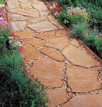 walkway-- I like the way the pebbles are in the cracks between the large flat stones.  It seems to give a nice even look so not to fall.