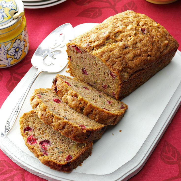Cranberry Zucchini Bread Recipe -Nutmeg and cinnamon add spice to these flavorful loaves from Alice Manzo of South Easton, Massachusetts. The flecks of green zucchini and red cranberries give each slice a festive look that's just right for the holidays.