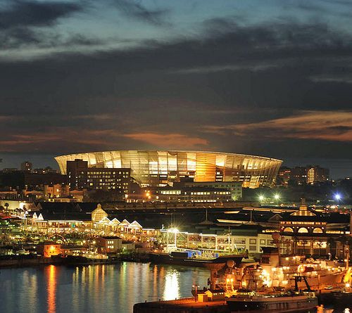 Cape Town - V&A Waterfront with the Cape Town Stadium behind it.