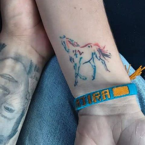 Pretty rainbow horse tattoo by @alexflorestattoo