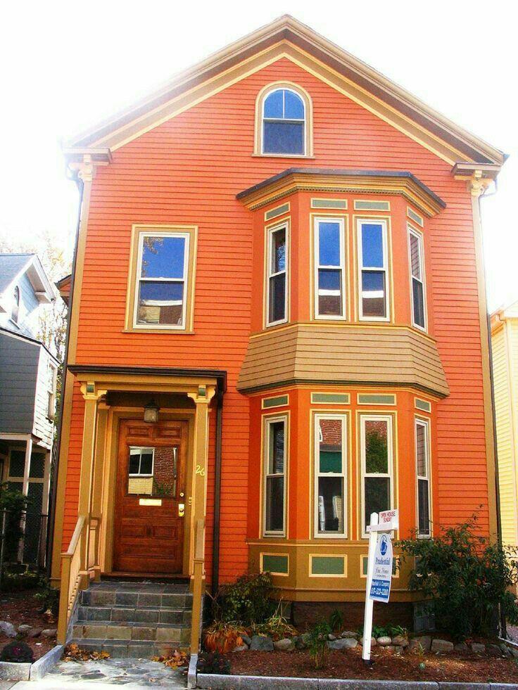Ярко оранжевые деревянные дома фото