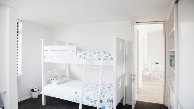 25 Kids' Rooms You'll Both Love!: Colorful accents and sophisticated antique finds do have a place in your child's room—right next to their favorite toys.