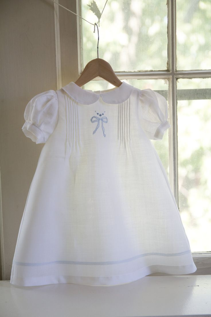 Dress with pin tucks, shadow work embroidery and tucks around the hem