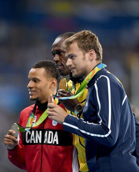 Silver medalist Andre De Grasse of Canada gold medalist Usain Bolt of Jamaica…