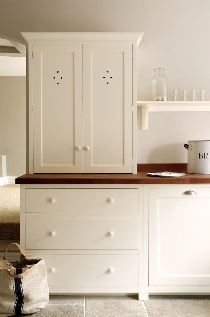 The Real Shaker Kitchen by deVOL.  cab doors, simple feet, panels, not to ceiling, butcher block, shelving