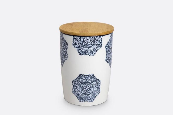 "Medium canister with wooden top. Measures 7""H x 5""D. Stoneware with white glaze and dark blue lace pattern. Stoneware is microwave and dishwasher safe. Wooden top can be hand washed with warm water, mild soap and a soft sponge.  Towel dry the wooden top. Don't submerge the wooden top in water.  SKU# VB56017"