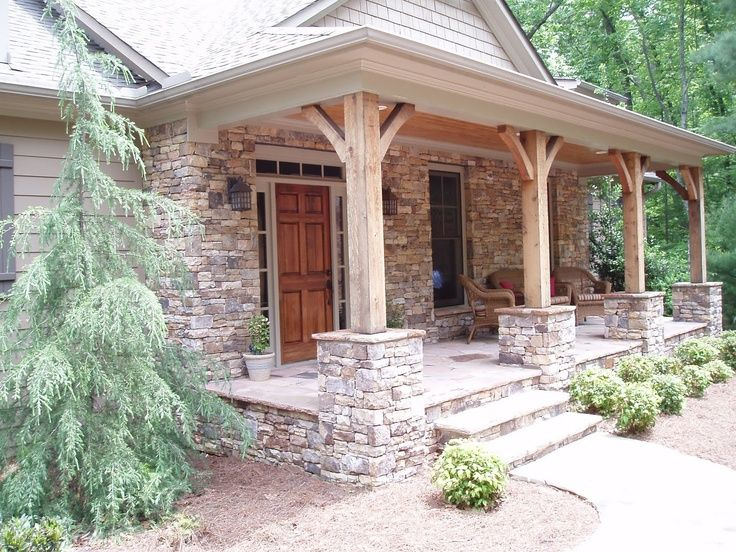 Stacked stone pillars with wood columns for the front for Rustic porch columns