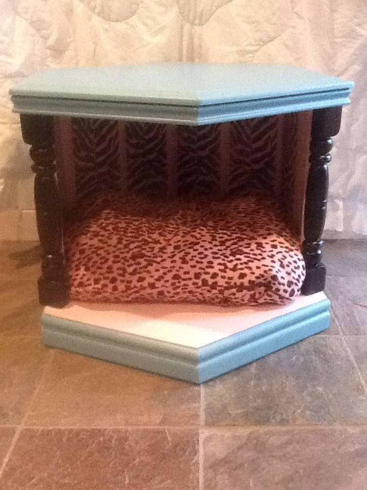 An end table that doubles as a pet bed. This vintage end table has been given a new life going from 1970's Mediterranean boring to Barbie Doll turquoise and pink. Added to the bling factor are zebra stripes inside softened with a glaze. The pink leopard print plush fleece is a pillowcase style so you can throw it in the wash anytime without any fuss. This deluxe pet bed will comfortably fit a dog or cat up to about 20 lbs. $90 plus shipping.
