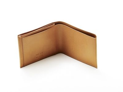 simple natural leather wallet from Isaac Reina. $208