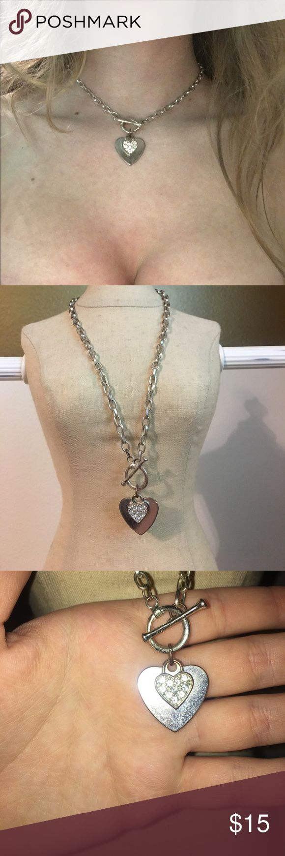 Silver Chain Heart Necklace Beautiful silver heart necklace with smaller diamond studded heart. Hits at the collarbone for a flattering finish to any outfit Jewelry Necklaces
