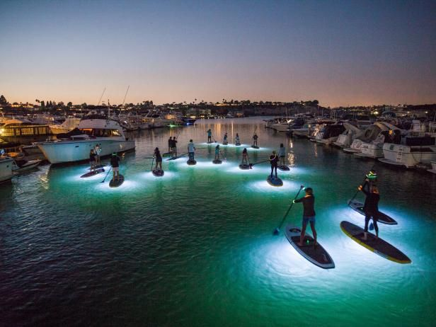 Discover after dark water sports like paddle boarding, kayaking and diving with Roam, the Travel Channel blog.