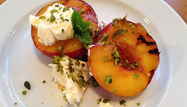 Grilled Peach with Mascarpone and Pistachios.