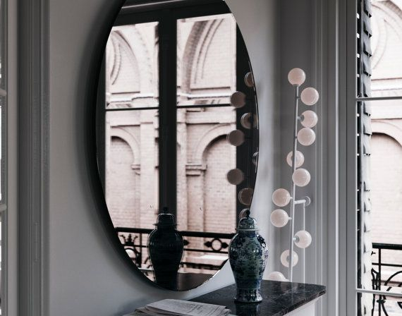 Handmade black mirror with Deco and MidCentury inspiration. Round, decorative wall mirror hand made with black glass.  For custom sizes, please