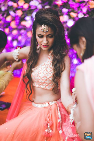 Bride on mehendi day , sleeveless blouse , orange and gold bride , hairstyle , maang tikka