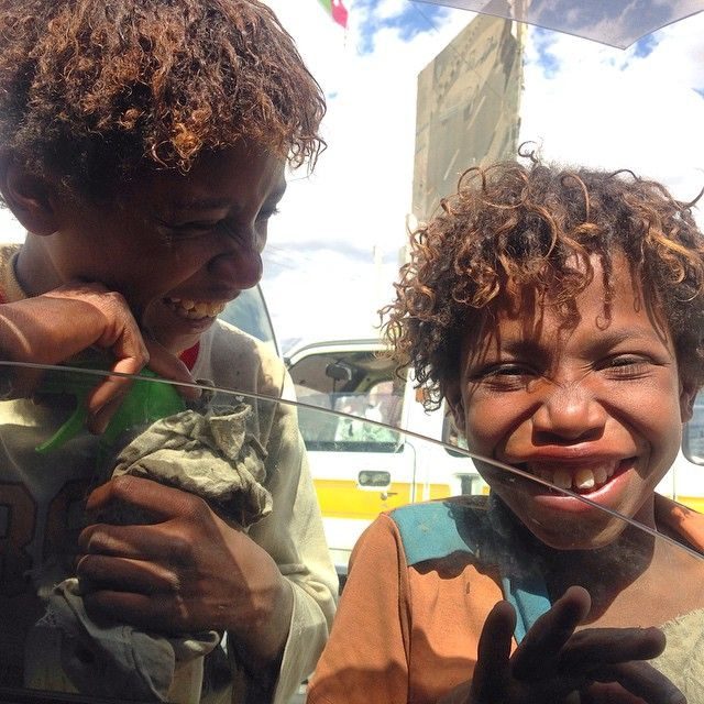 At a traffic light, two boys share a laugh and smile. A reminder on this day, as sounds of fighter jets souring the skies of ‪#‎Sanaa‬ that there's still hope for a happier Yemen tomorrow. Photo by Nina Aqlan. ‪#‎yemen‬ ‪#‎everyday_yemen‬ ‪#‎everydayeverywhere‬