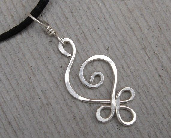 We hammered and swirled 18 gauge sterling silver wire to make this Celtic inspired light weight pendant. It measures about 1 1/2- 1 3/4( 3.8-4.5cm) from the top of the sterling silver bail to the bottom of the pendant. It is about 5/8(1.6cm) across the widest part. It is the same size as our sterling silver Celtic budding spiral earrings but with a bail added to it. This pendant comes with a simple black satin cord that can be tied to any length. If youd prefer a cord or chain with a clasp…