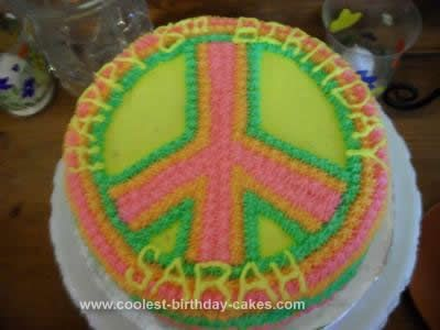 Homemade Peace Sign Birthday Cake: My daughter is into the peace sign craze, so we did it as the theme for her 8th birthday party.  For her cake, I tried to keep it simple, but it still