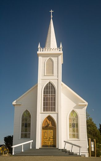 Old fashioned white church with steeple