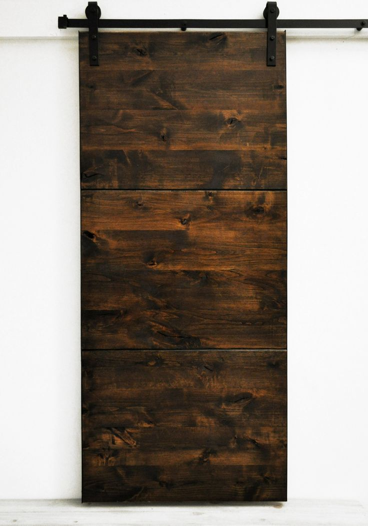 "Large slab panels of solid wood express a minimalist modern appearance. Standard door sizes are 82""H x 36""W and the larger 96""H x 48""W. Our collection of Dogberry sliding barn doors has quickly become"