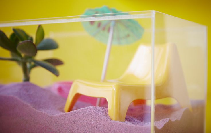 Why not use an acrylic display box like BJÖRNARP from IKEA to make a mini beach box? You can fill it with sand (even pink sand), a doll's easy chair, a potted plant and even a drink umbrella.