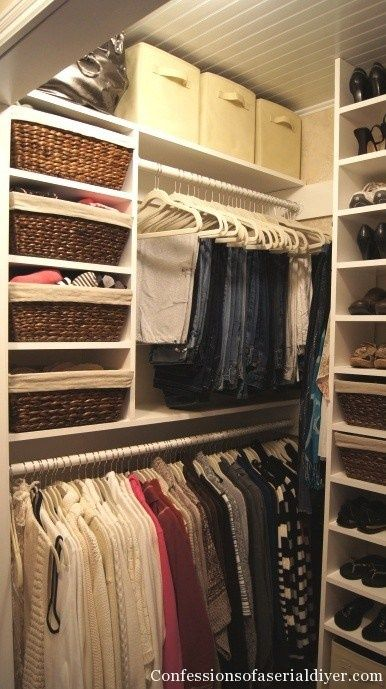 Storage bins, baskets, open shoe shelving and slimline hangers make sure every inch of storage in this closet is maximized and organised