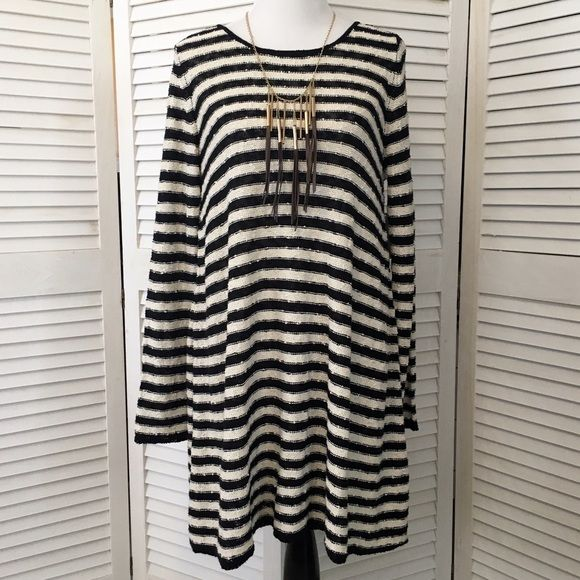 Free People Counting Stripes swing tunic / dress So cozy and cute. Mid weight slubby knit in black and ecru stripes. Long sleeves, scoop neck. Flattering swing silhouette. Sexy low-cut V back. Wear as a dress or a tunic! NWT; never worn. Free People Dresses Long Sleeve