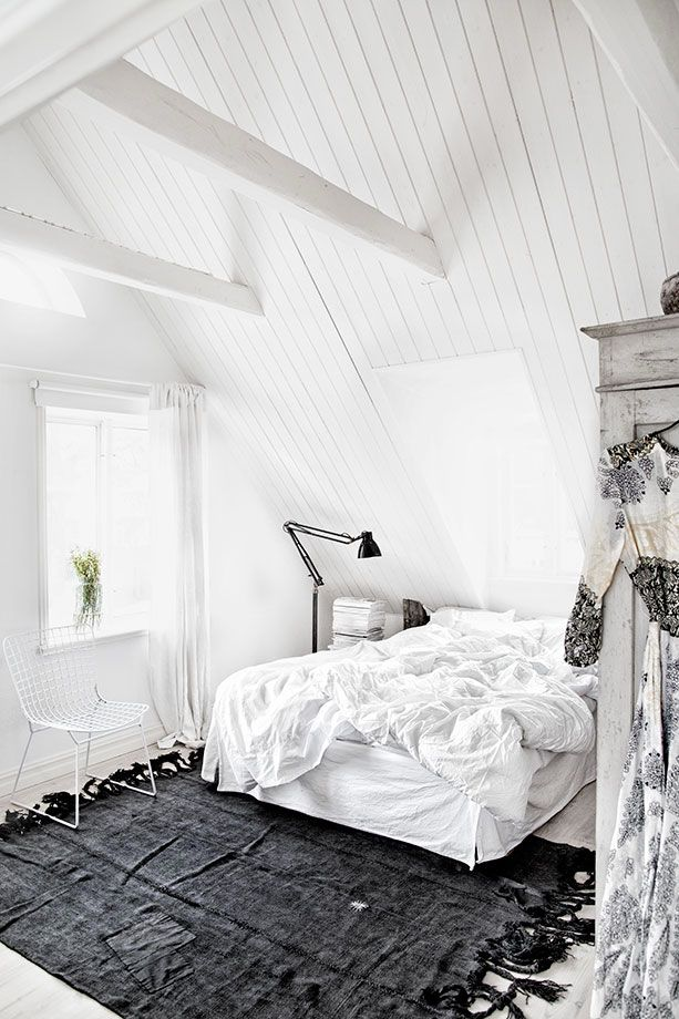 White attic room with gorgeous black rug