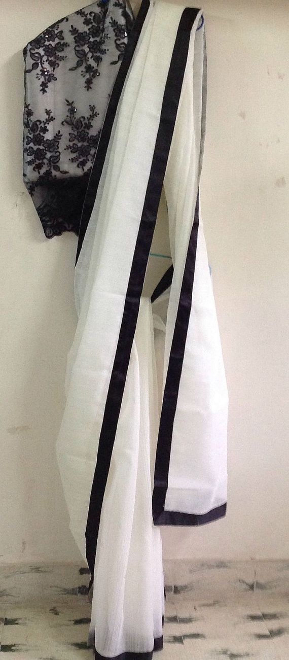Black Silk border on white Cotton Saree.. with Designer blouse piece.. get it at http://mytailor.in/