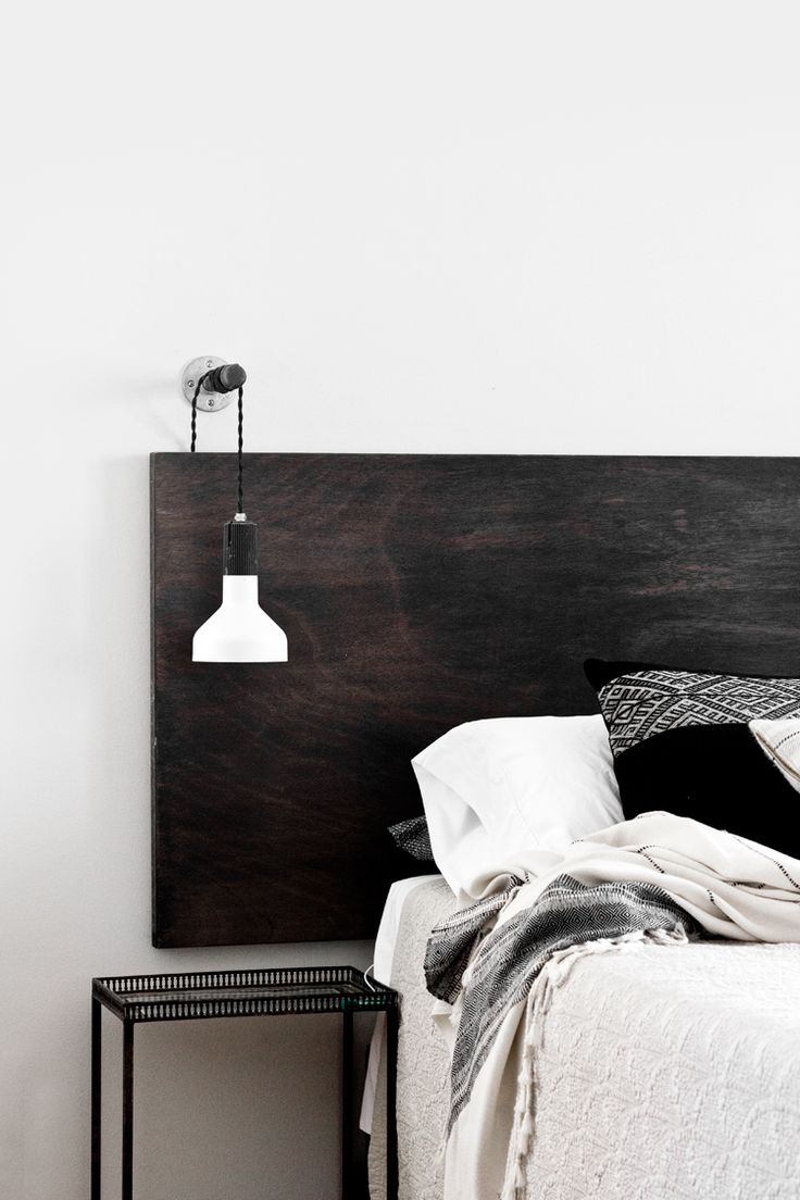 Love the bed head here and the hanging bedside light.