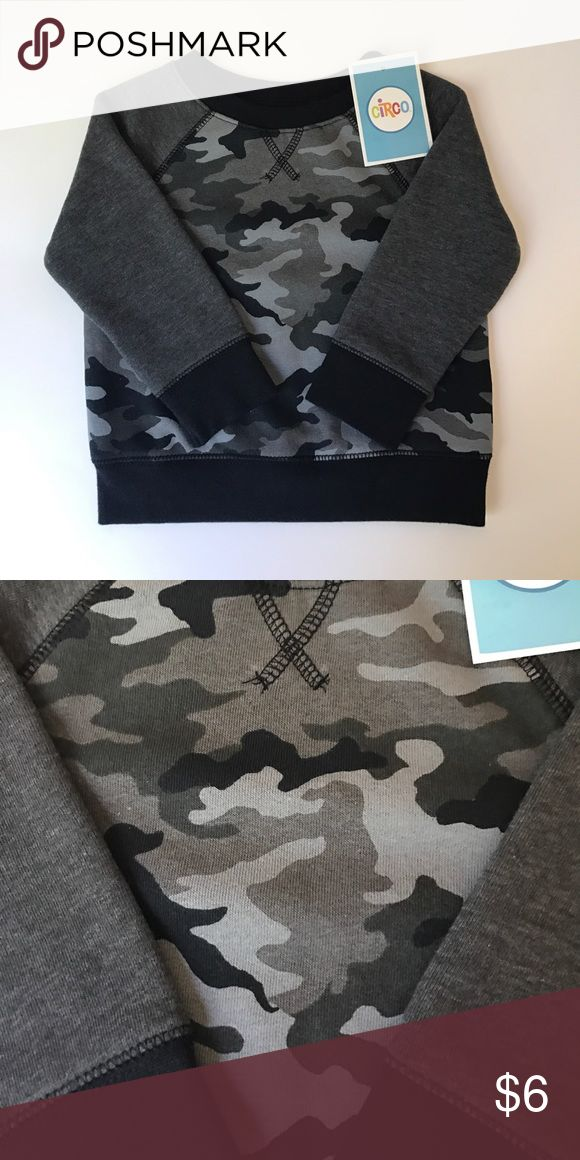 Camouflage Sweatshirt Circo Camouflage Sweatshirt. Size 12 Months. NWT. Bought without thinking about what season my son would be wearing this by. Perfect for fall/winter/spring 12 month olds. (I have a summer 12 month old ) My loss is your gain! Circo Shirts & Tops Sweatshirts & Hoodies
