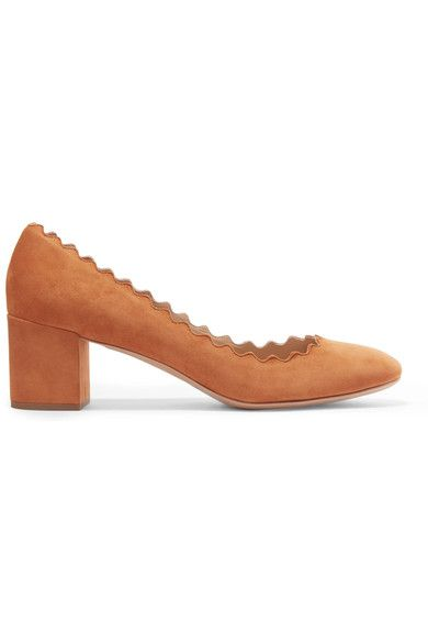 So chic and timeless are Chloé's signature 'Lauren' pumps that they come in an array of colors to suit every occasion. Beautifully made in Italy, this tan suede pair reflects the label's '70s spirit with a sturdy block heel and feminine scalloped trims. We think they look cool styled with flared denim.