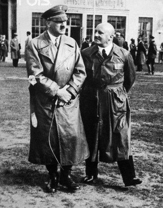 Hitler with his whip and Julius Streicher, late 1933. (via putschgirl)