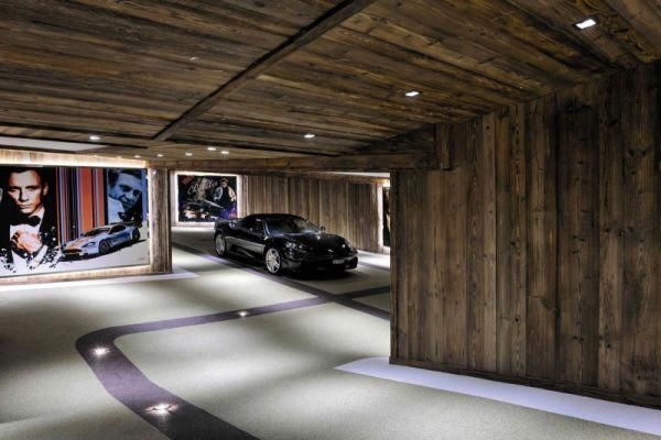 The First Garage Door Opener Consisted Of A Radio Transmitter A Receiver And An Actuator To Open Or Close The Door Parking Design Garage Design Luxury Garage