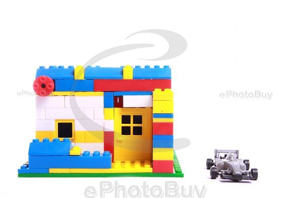 Villa structure built using building block with toy car