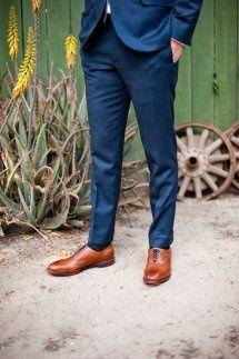 blue suit, brown shoes/belt