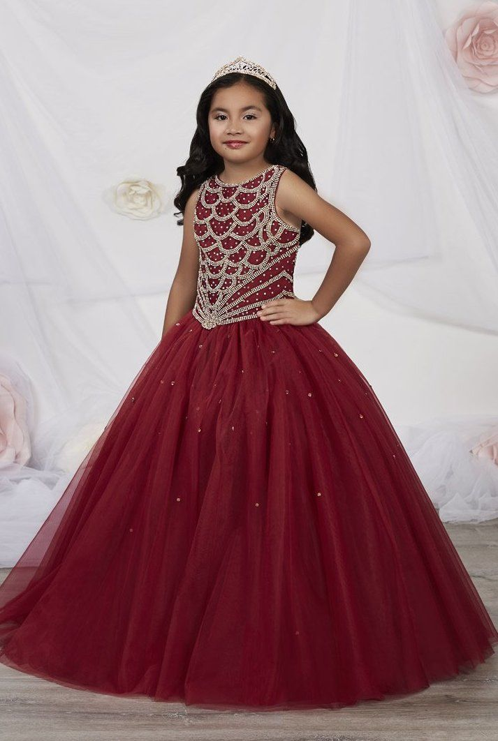 44813ee2045 Tiffany Princess 13533 is a pageant girl s ball gown that has a scoop  neckline with a full rhinestone beaded sleeveless bodice and a glitter  tulle ball gown ...