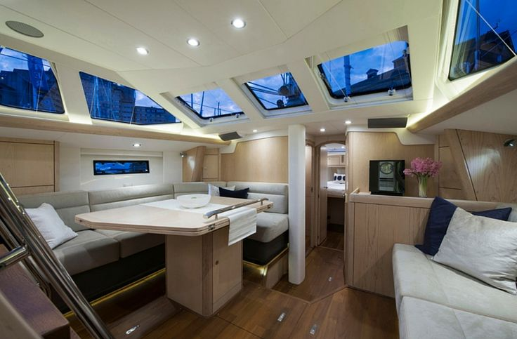 """At the center of the """"Oyster 475"""", five well designed stairs descending from the companion way lead to the main salon. For a boat with a center cockpit, these stairs are easy to navigate as they are a generous width and a moderate hight with set at an angle that is easy to scale.  See more of her here: http://www.saltsailing.com/oyster-475-salon/"""