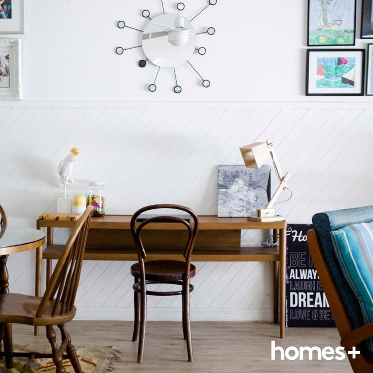 The #study #nook in Karen's home is #decorated with #artwork by the kids. As featured in the May 2015 issue of homes+. #beach #style #home #interior #decor #table #chair #lamp #rug #homesplusmag