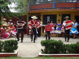 Traditional Chilean dance by a family of Huasos. Huasos are Chilean cowboys and are known for their great skill on horseback.