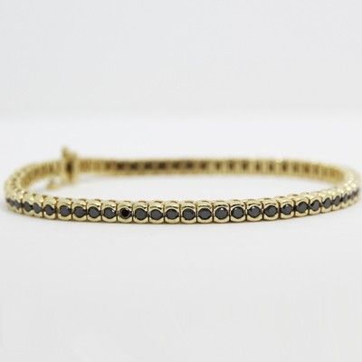 This insidious 3.0 carats black diamond bracelet in 14k yellow gold is alluring enough to turn a few heads.