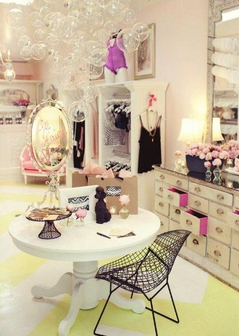 I love the bubble light fixture and the offset color to the dresser drawers