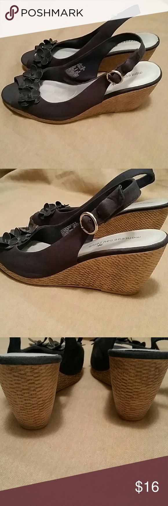 Navy wedge sandal size 10 Body of shoe is fabric and little flowers on front are faux patent leather.  Wedge heel has natural woven look. Montego Bay Club Shoes